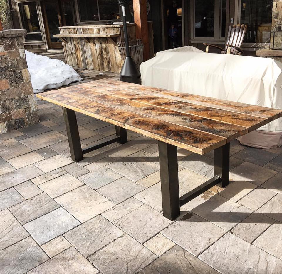 Outdoor table with Steel base. Reclaimed Wood furniture Scavenger Woodworks