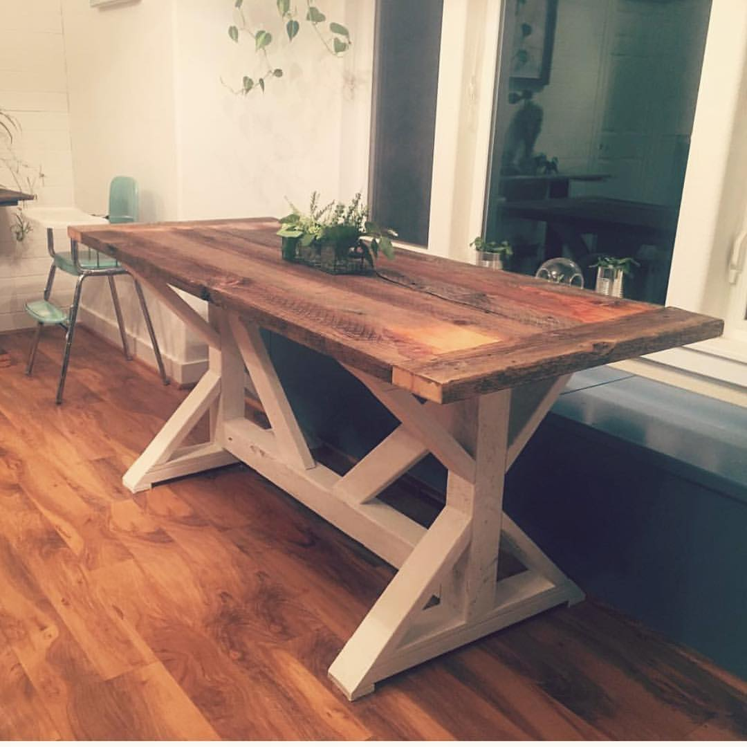 6-person Farm Style table with reclaimed barn wood top and white base made in Bend, OR.