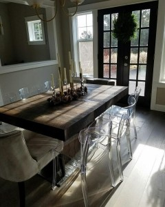 Custom dining table with leaf insert made from reclaimed barn wood in Bend, OR.
