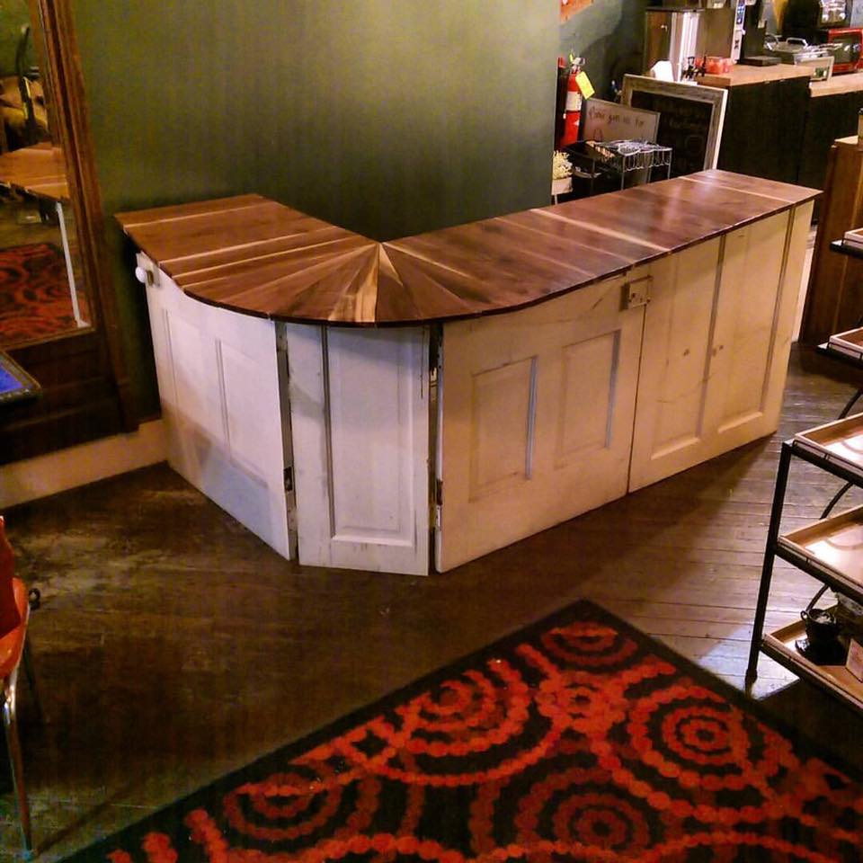 ... Bar Top Made From Reclaimed Walnut Wood And Vintage Doors At The Creme  Coffee House In ...