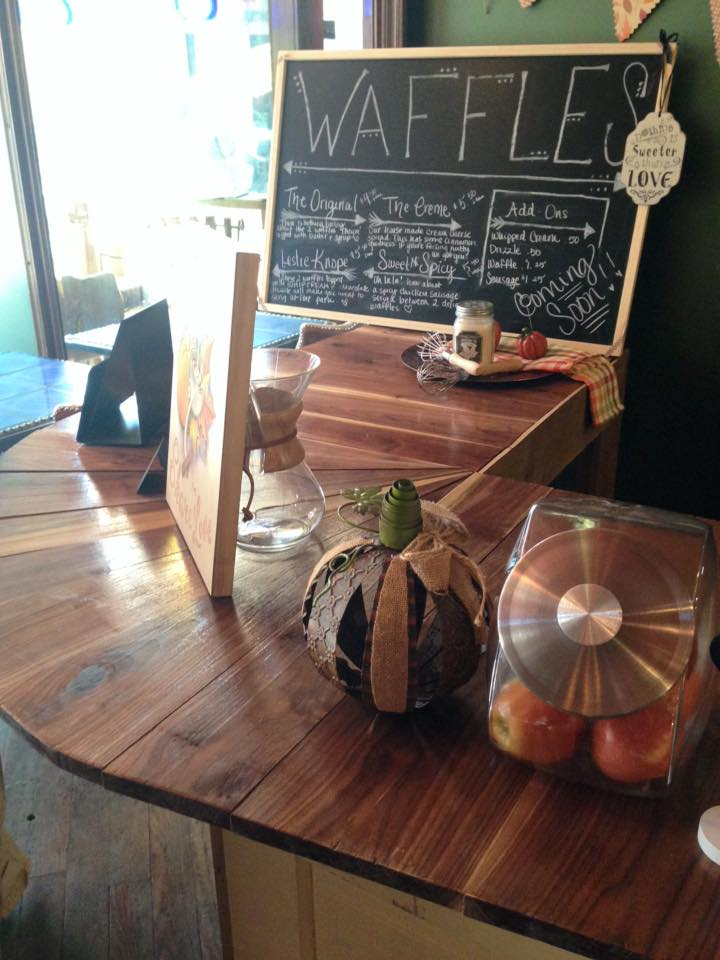 Bar top made from reclaimed walnut wood and vintage doors at The Creme Coffee House in Owensboro, Kentucky