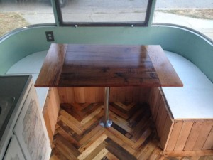 Table made from reclaimed walnut wood in an Airstream Argosy
