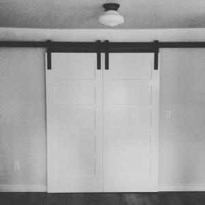 Custom White Barn doors with metal hardware in Bend, Oregon