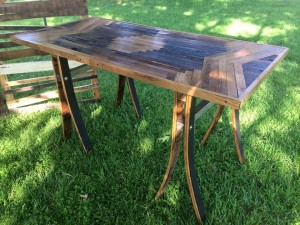 Large table made from reclaimed barn wood with custom design. This table is available to purchase and can be seen in the showroom of Studio Slant in Owensboro, Kentucky.