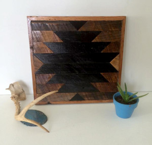 Black and brown aztec/native american inspired wall decor.