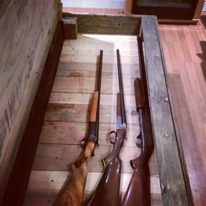 Interior of a large coffee table/gun cabinet made from barn wood