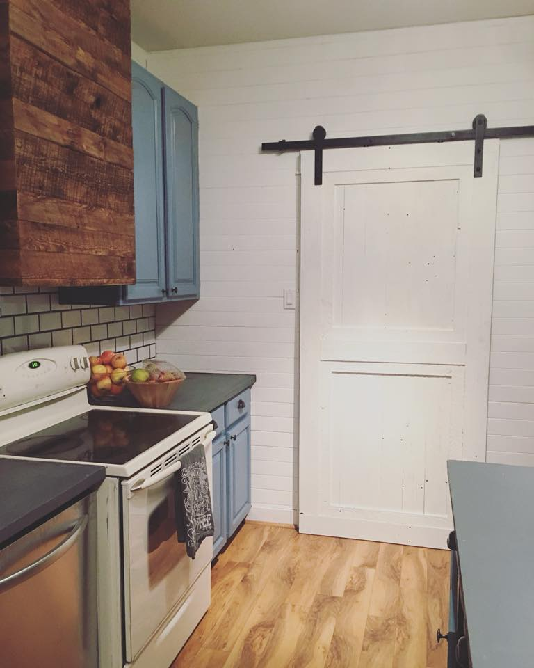White sliding barn door with hardware in bend, oregon. Shiplap Wall.