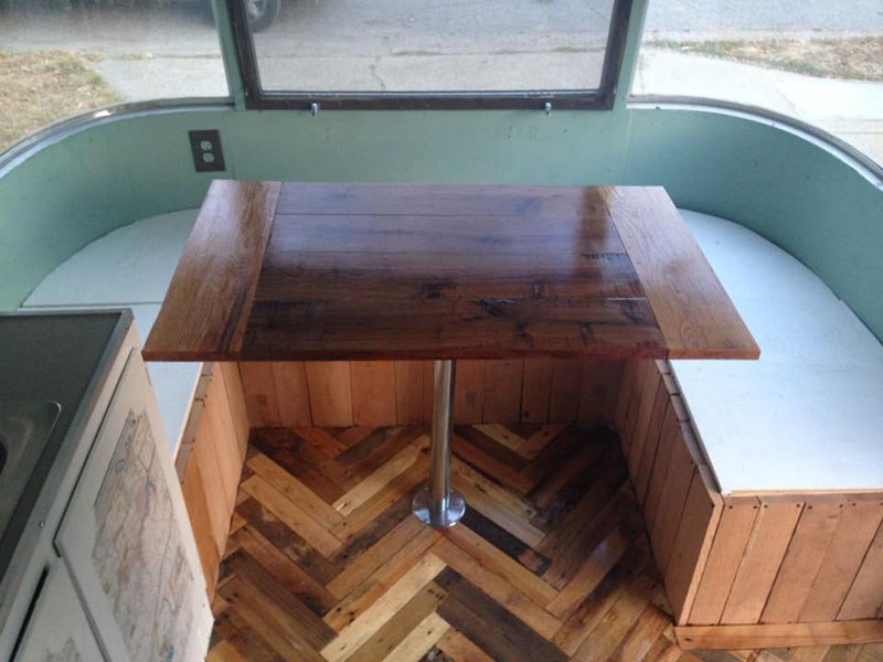 Custom Walnut Table Top in our Airstream Argosy. The Flooring is made from Reclaimed Pallets.