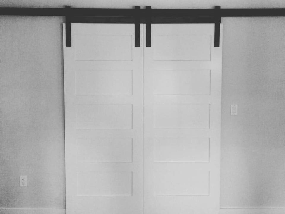 White sliding barn door with hardware in bend, oregon.