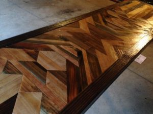 Inlaid geometric table by Scavenger Woodworks